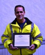 Dennis Fazio holding certificate