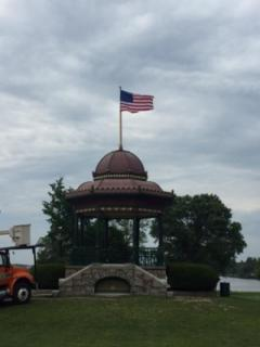 The gazeebo with an American Flag on top