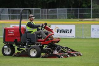 Toro tractor mowing a sports field